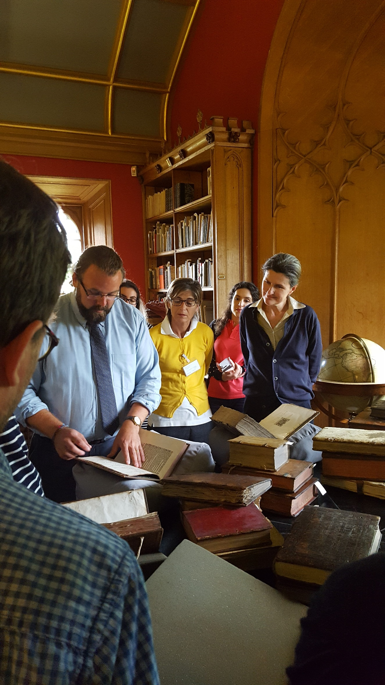 Daryl Green, Librarian of Magdalen College, explaining the content of marginal annotations.