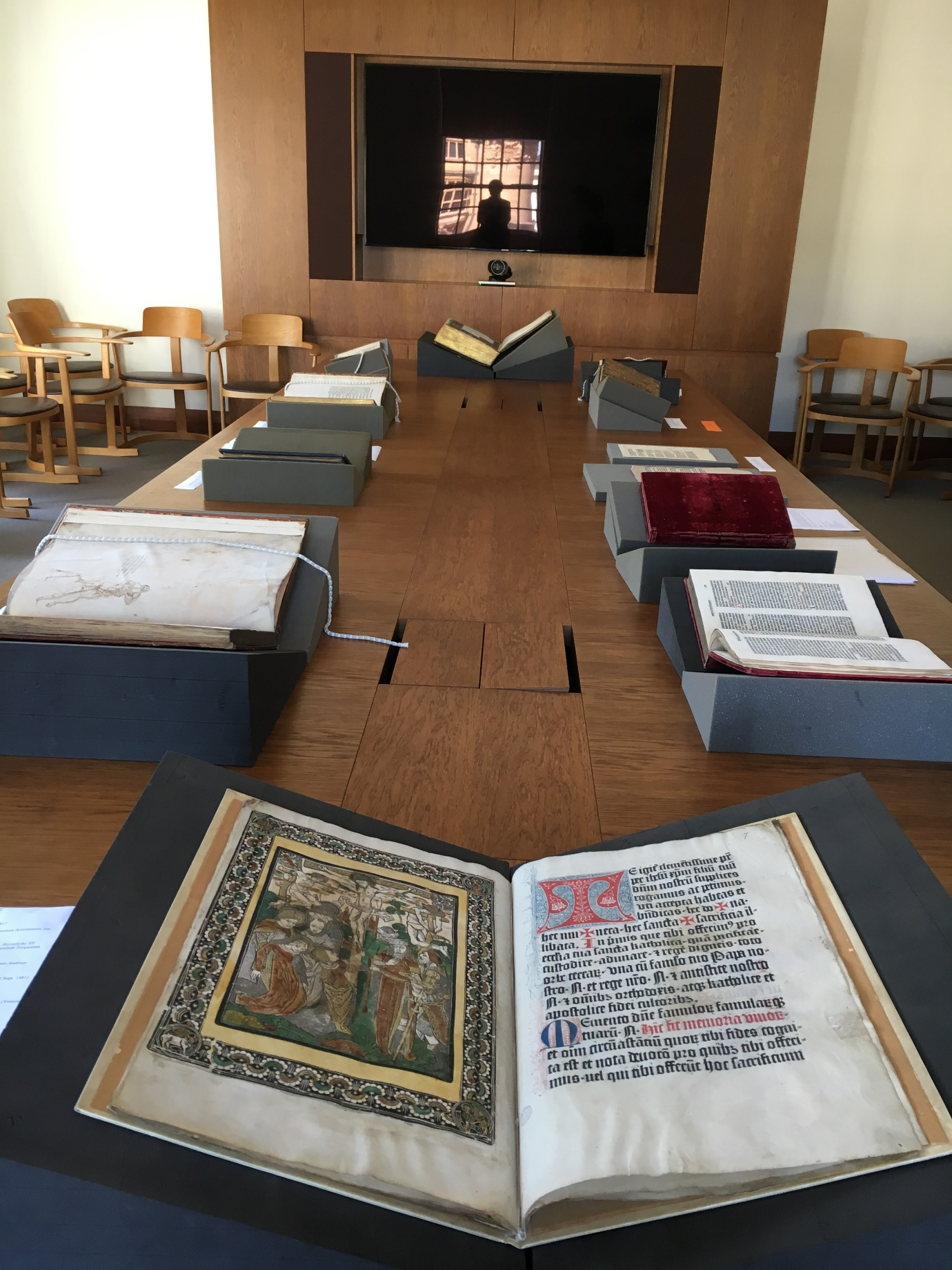 The display in the Bahari Room, Weston Library. The Mainz Canon Missae at the front, the drawing of Marco Zoppo on the front endleaf of Clemens V's Constitutiones, and opposite, a rare surviving copy of a Paris Missal, in two volumes, camouflaged in revolutionary legislation.